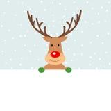 拿着一副空白的横幅的逗人喜爱的圣诞节驯鹿 免版税库存图片