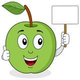 拿着一副空白的横幅的绿色苹果计算机 免版税库存照片