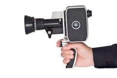 拿着一台老影片照相机的手 免版税库存照片