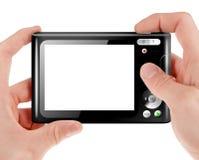 拿着一台紧凑数字照相机的手 免版税图库摄影