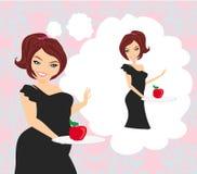 拿着一块板材用苹果的饮食的女孩 图库摄影