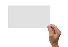 拿着一张白色空白的海报的手 免版税库存图片