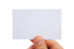 拿着一张空白的名片的手 免版税图库摄影