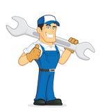 拿着一把巨大的板钳的技工或水管工 免版税库存照片
