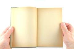 拿着一本旧书 免版税库存照片