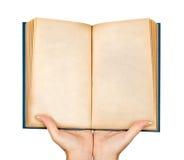 拿着一本开放空白的书的两只手 库存图片