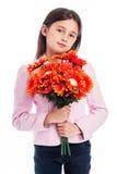 拿着一束花的女孩。 免版税图库摄影