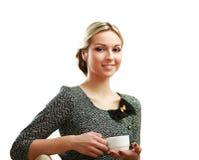 拿着一杯咖啡的少妇在她 免版税库存图片