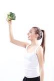 拿着一棵绿色硬花甘蓝的女孩 库存照片