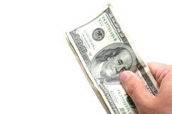 拿着一系列的钞票的手 免版税库存图片