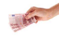 拿着三10张欧洲票据的手 免版税图库摄影