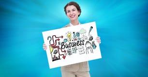 拿着与企业文本的广告牌和各种各样的象的女实业家画象反对蓝色backgr 库存图片