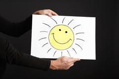 拿着与太阳的人海报 库存照片