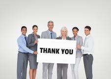 拿着与感谢的商人一张卡片您发短信 免版税库存照片