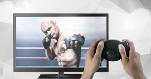 拿着与混杂的武术战斗机的手赌博控制器在电视上 库存照片