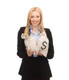 拿着与美元的女实业家金钱袋子 库存图片