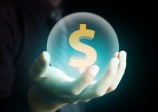 拿着与美元的符号的商人水晶球 库存照片