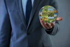 拿着与自然照片的人地球 免版税库存照片