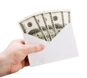 拿着与货币的现有量一个信包 库存图片