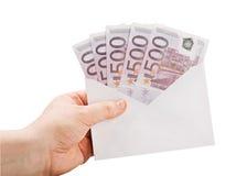 拿着与货币的现有量一个信包 库存照片