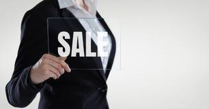 拿着与销售文本的女商人一块玻璃 免版税库存图片