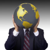 拿着世界地球的商人 库存照片