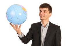 拿着世界地球的愉快的行政人 库存照片