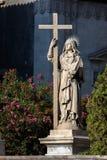 拿着书和十字架的圣徒阿佳莎雕象 库存图片