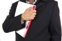 拿着书的商人 免版税库存图片