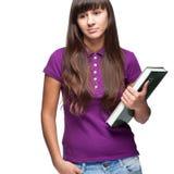 拿着书的女孩 免版税图库摄影