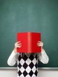 拿着书的年轻女性书呆子 免版税库存照片