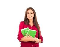 拿着书的年轻拉丁女孩 免版税库存图片
