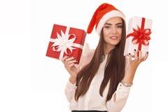 拿着二个礼物盒的圣诞节女孩 免版税库存照片