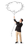 拿着云彩气球图画的英俊的人 库存图片
