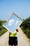 拿着云彩的图片一个人的概念 免版税库存图片
