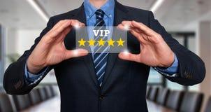 拿着五星的商人对VIP -办公室估计-储蓄图象 免版税库存图片