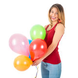 拿着五颜六色的气球的俏丽的妇女被隔绝在白色背景 免版税图库摄影