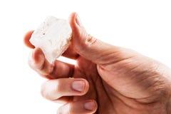 拿着亚硒酸盐石头 免版税库存图片