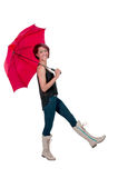 拿着伞的妇女 免版税库存图片