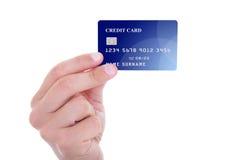 拿着信用卡的男性手被隔绝在白色 库存图片