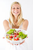 拿着健康食物的愉快的少妇 免版税库存图片