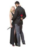 拿着刀子奸贼的女孩 人与在他的起来了 库存图片