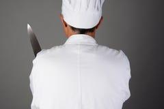 拿着刀子的厨师 免版税库存照片