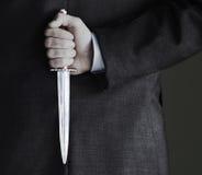 拿着刀子的商人的中央部位 库存图片