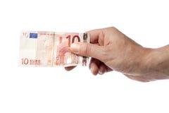 拿着十欧元票据的手 免版税库存照片