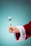 拿着叉子的圣诞老人手 库存图片