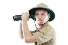 拿着双筒望远镜的探险家 免版税库存图片