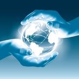 拿着发光的地球地球在手上-拯救世界 库存图片