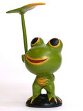 拿着叶子的木青蛙 库存照片