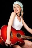 拿着吉他的华美的少妇 免版税图库摄影